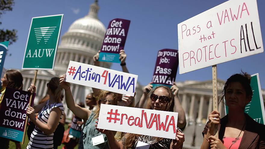 Image: Demonstrators hold a rally in support of the Violence Against Women