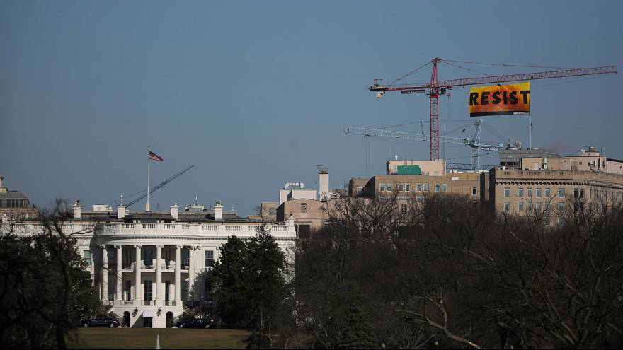 "Greenpeace take over crane near White House to display ""Resist"" message"
