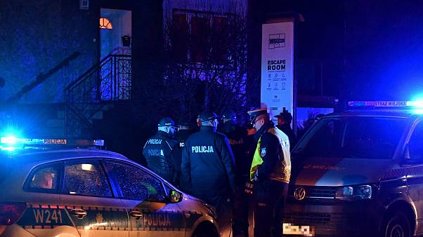 """Image: Police secure the scene of a fire in an """"escape room"""" that killed fi"""
