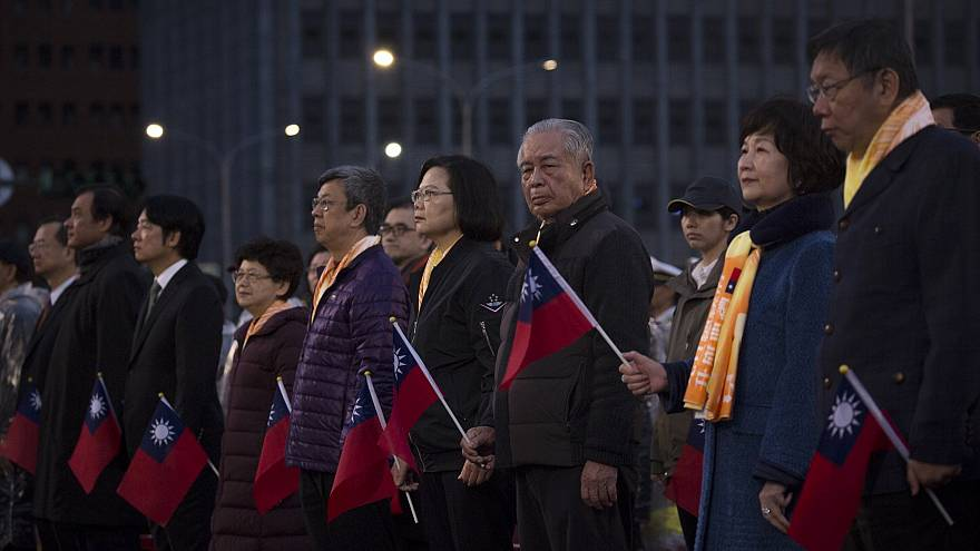 Taiwan president urges China to use peaceful means to solve differences in