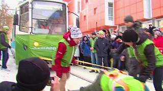 Russian woman drags two tram cars