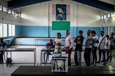 Congolese voters wait to cast their ballot at a school in the popular N\'djili district, in Kinshasa, on Dec. 30, 2018.
