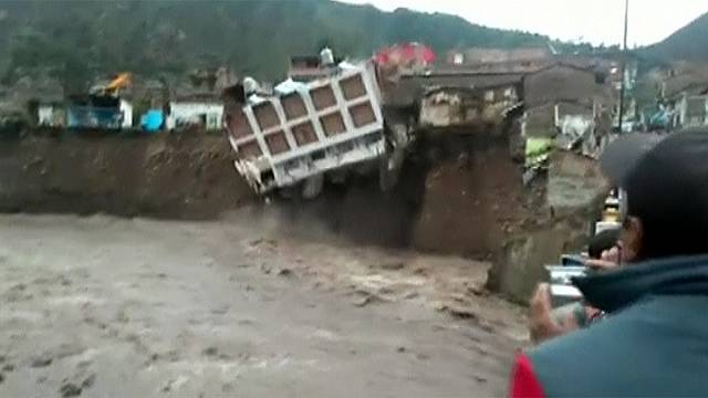 Watch: Hotel crashes into river as heavy rains hit Peru
