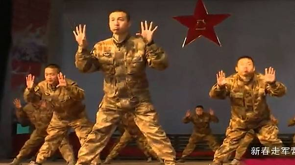 Chinese soldiers perform 'rooster dance' to ring in the New Year