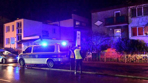 """Image: FPolice secure the scene of a fire in an """"escape room"""" that killed f"""