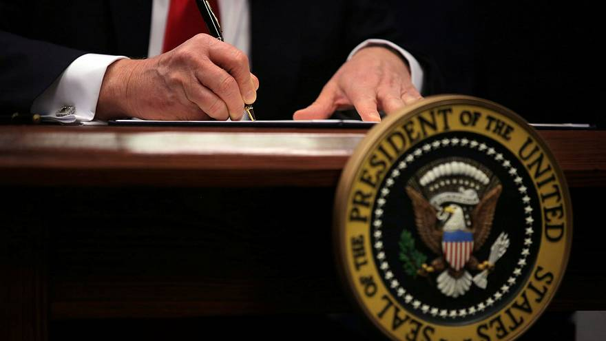 Trump signs ''extreme vetting'' executive order banning Syria refugees from entering the US indefinitely