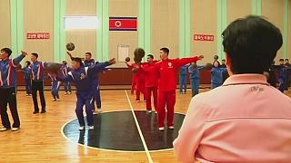 N.Korea: basketball players turn to gymnastics to improve suppleness