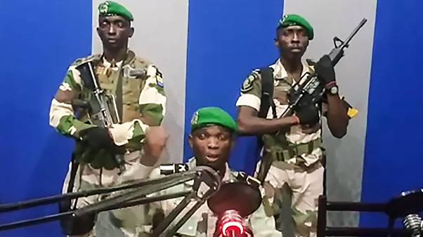 """Image: Gabon soldiers on state radio called on the people to """"rise up"""" and"""
