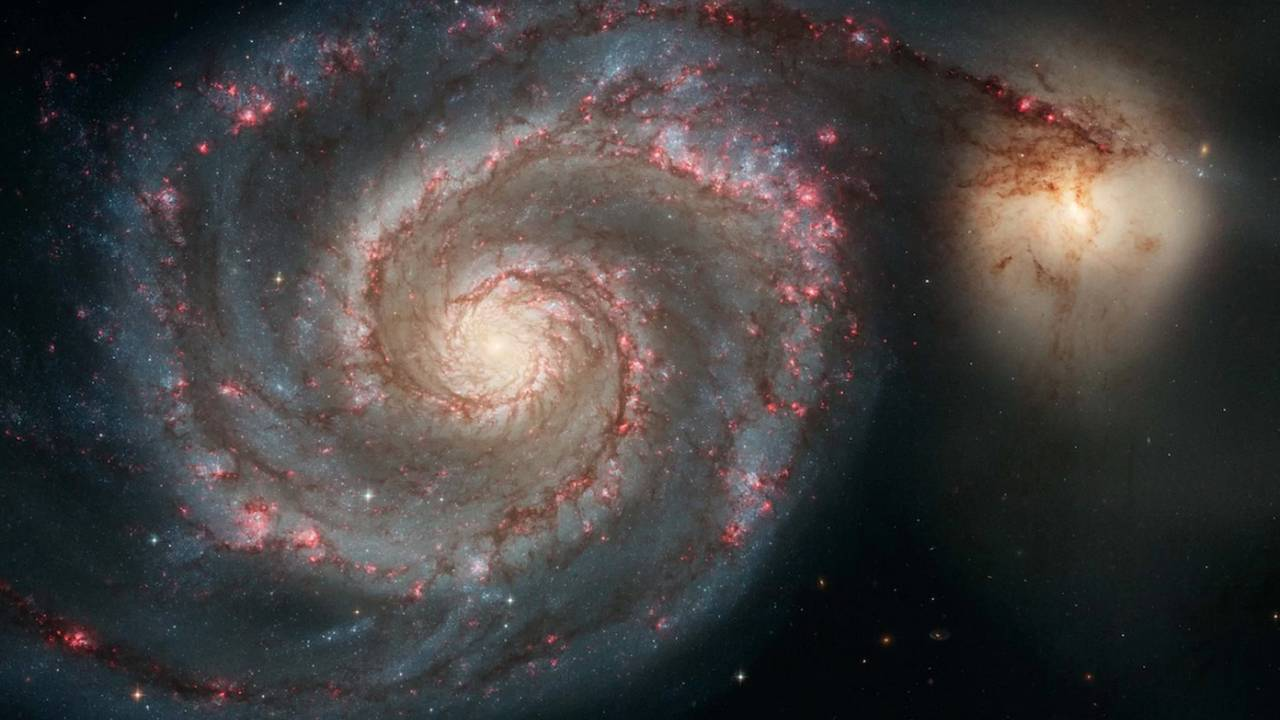 Looming galactic collision will rip open the black hole at the Milky Way's center