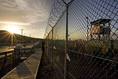 The sun rises over Camp Delta detention compound at Guantanamo Bay U.S. Naval Base in 2008.