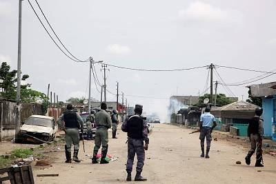 Security forces patrol Libreville on Monday.