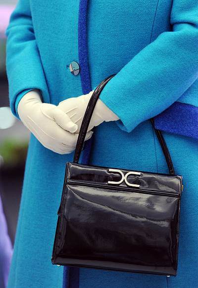 The bag pairs well with white gloves, another favorite accessory of the queen.