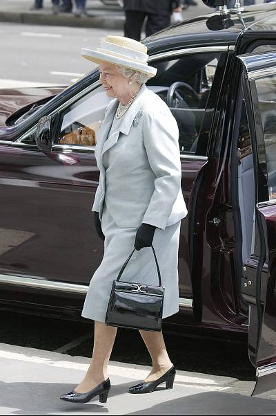 The queen and her trusty bag were spotted out and about in 2004, when the queen opened the Tanaka Business School at Imperial College in London.