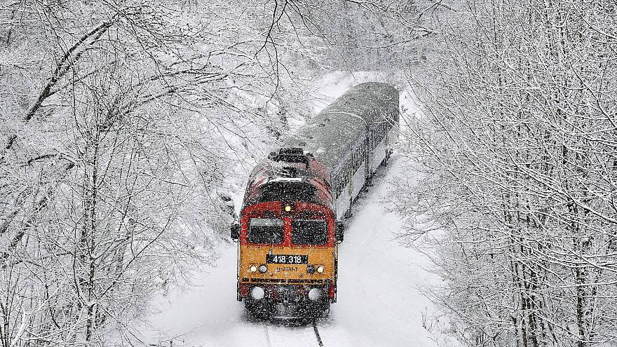 Image: A train crosses the Cuha Valley during heavy snowfall near Vinnye, H