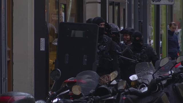 Police raids across Paris after ''terror'' suspect is shot by a soldier at the Louvre museum