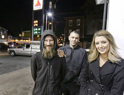 Johnny Bobbitt Jr., left, Kate McClure, right, and McClure\'s boyfriend Mark D\'Amico at a Citgo gas station in Philadelphia on Nov. 17, 2017.  McClure and D\'Amico raised more than $400,000 for Bobbitt Jr., a homeless man after he used his last $20 to fill up the gas tank of a stranded motorist in Philadelphia.
