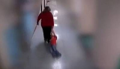 A teacher at Wurtland Elementary School is seen dragging a 9-year-old autistic student down the hallway in Greenup County, Kentucky.