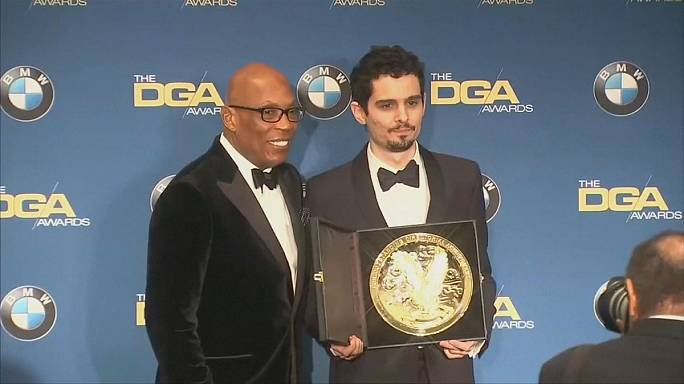 La La Land wins another top award as director Damien Chazelle criticises Donald Trump