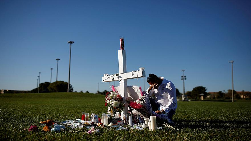 Image: Joe Zevuloni mourns at a memorial for the victims of a shooting at M