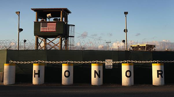 Image: A U.S. military guard tower at Guantanamo Bay detention center in Cu