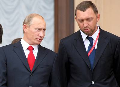 Russian Prime Minister Vladimir Putin speaks with Oleg Deripaska at an investment forum in Sochi in 2008.