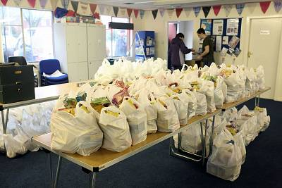 Volunteers prepare shopping bags full of groceries to be distributed to struggling households The Bread and Butter Thing charity in Oldham, England.