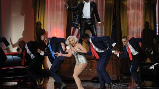 Image: Singers R. Kelly and Lady Gaga perform onstage during the 2013 Ameri