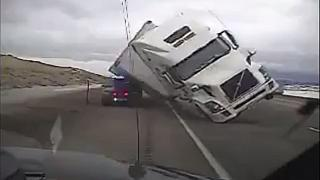 Truck lands on police car in high winds