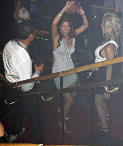 Soccer star Cristiano Ronaldo is pictured with Kathryn Mayorga, center, in Rain Nightclub in Las Vegas June 2009.
