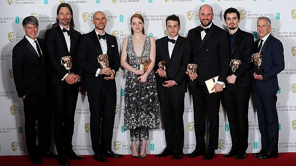 BAFTA stars show off their trophies