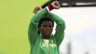 Ethiopia's Olympic protest athlete reunites with family, but still 'restless'