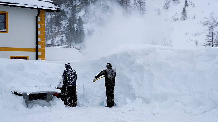 Image: Workers remove snow after a blizzard at the Obertauern ski resort in