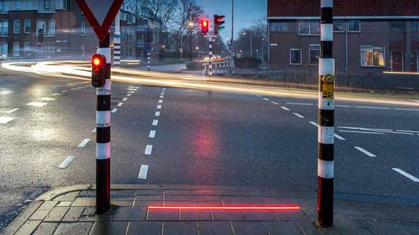 Floor lighting at pedestrian road crossing could prevent phone 'zombies' wandering into traffic