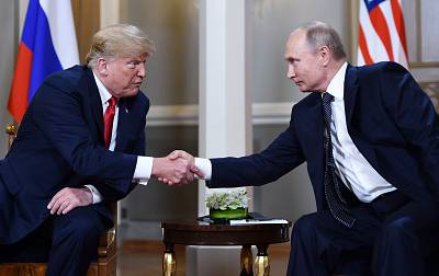 Vladimir Putin  and Donald Trump shake hands before a meeting in Helsinki on July 16, 2018.