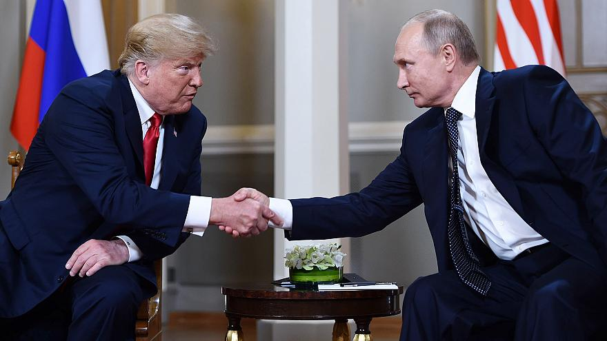 Image: Vladimir Putin  and Donald Trump shake hands before a meeting in Hel