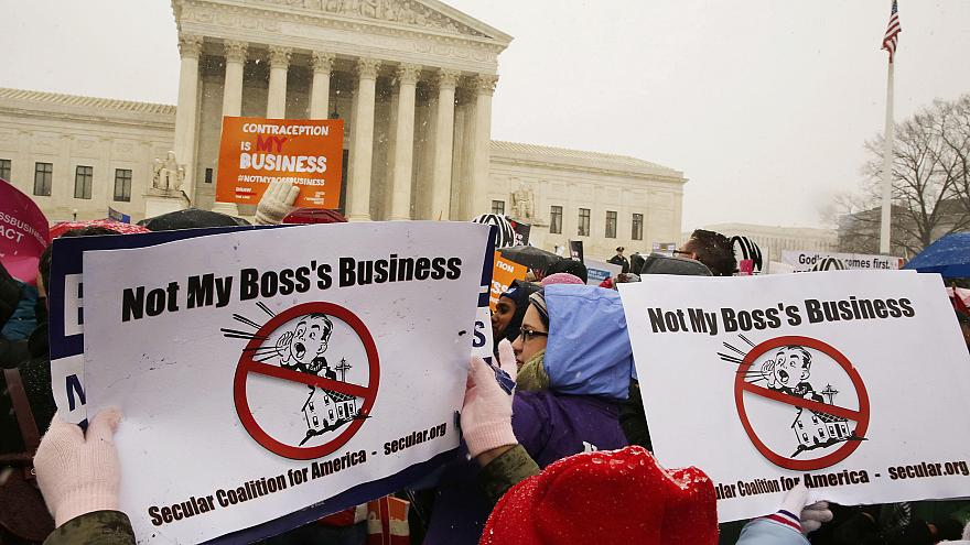 Protesters rally at the steps of the Supreme Court as arguments begin today