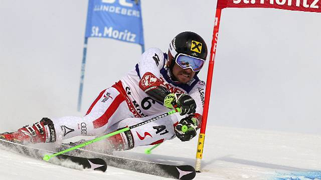 Hirscher seals giant slalom world title, as low-flying plane slices camera cable