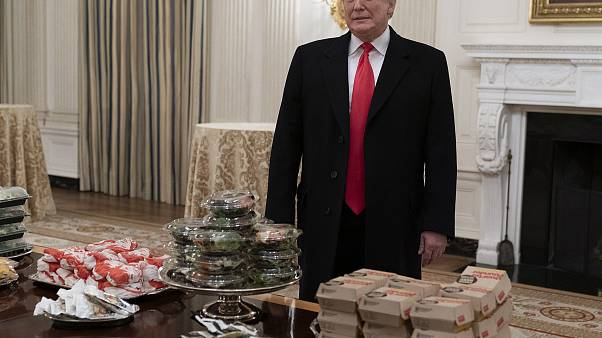 Image: United States President Donald J. Trump presents fast food to be ser