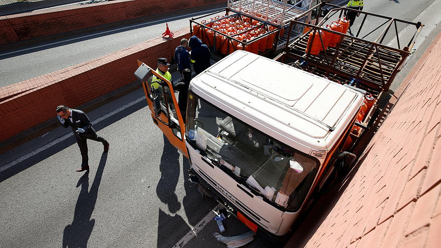 Spanish police stop truck laiden with gas canisters at gunpoint