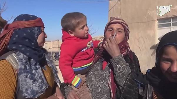 Syrian villagers celebrate ISIL's departure