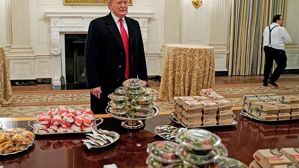 Image: U.S. President Donald Trump speaks in front of fast food provided fo