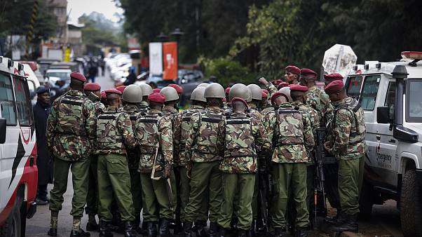 Image: Kenyan police officers prepare enter the complex in Nairobi on Tuesd