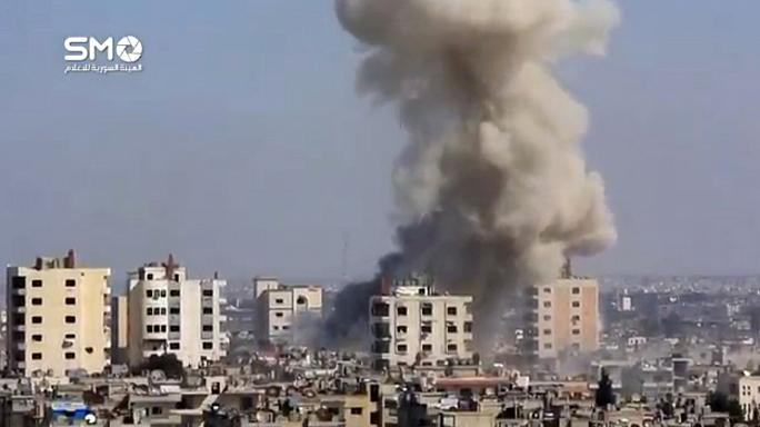 تفجيرات حمص تخيم على محادثات جنيف