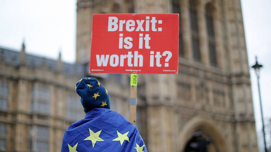 Image: Anti-Brexit supporters hold placards and flags as they demonstrate o