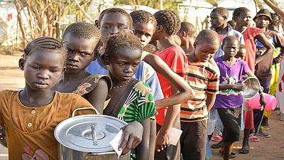 Famine-hit South Sudanese eat weeds and water lilies to survive