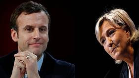 Le Pen lashes out at rivals as Macron tops latest polls