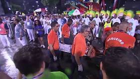 Rio carnival crash: at least a dozen people injured after float hits barrier