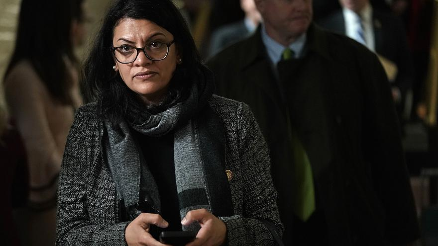 Image: Rep. Rashia Tlaib leaves a caucus meeting at the Capitol on Jan. 9,
