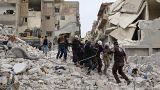 Síria: Bombas em Idlib, conversações em Genebra