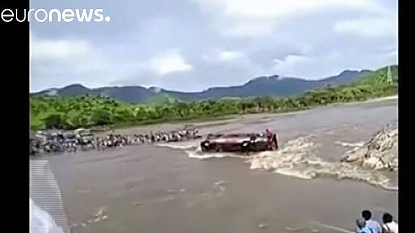 Watch: Passengers trapped after bus overturns into swollen river in Peru